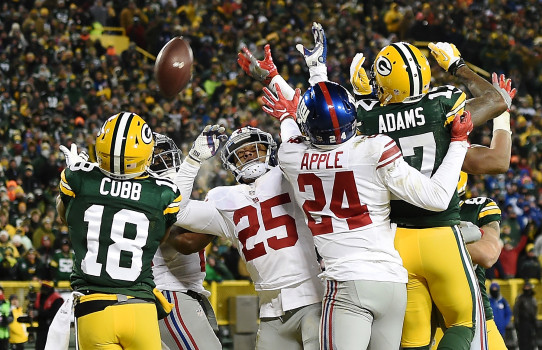 GREEN BAY, WI - JANUARY 08: Randall Cobb #18 of the Green Bay Packers catches a touchdown pass in the second quarter during the NFC Wild Card game against the New York Giants at Lambeau Field on January 8, 2017 in Green Bay, Wisconsin. (Photo by Stacy Revere/Getty Images)